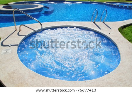 blue jet spa pool in green grass garden outdoor day