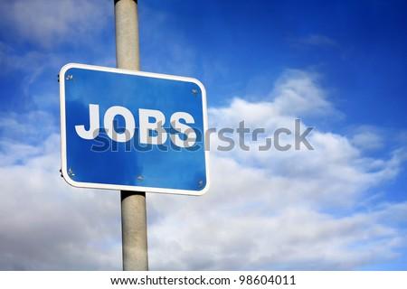 Blue jobs sign against a blue sky