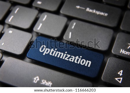 Blue key with Optimization word on laptop keyboard. Included clipping path, so you can easily edit it.