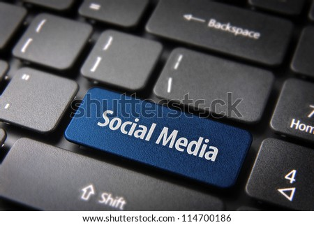 Blue key with Social media words on laptop keyboard. Included clipping path, so you can easily edit it.