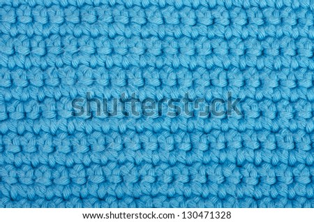 Blue knitted wool textured background