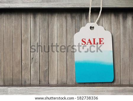 Blue label  paper or price tag on  brown wood background