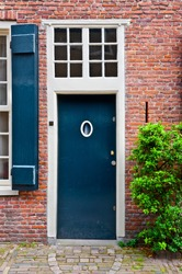 Blue Lacquered Door in the Dutch City