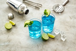 Blue lagoon cocktail drink with lemon juice and mint leaves