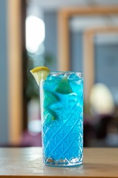 Blue lagoon cocktail served on wooden table