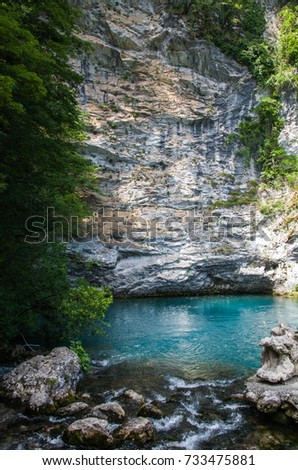 Blue lake in mountains with beautiful rock, Abkhazia #733475881