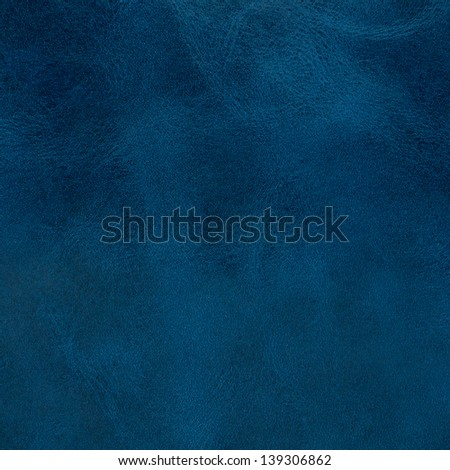 Blue leather texture closeup detailed background.