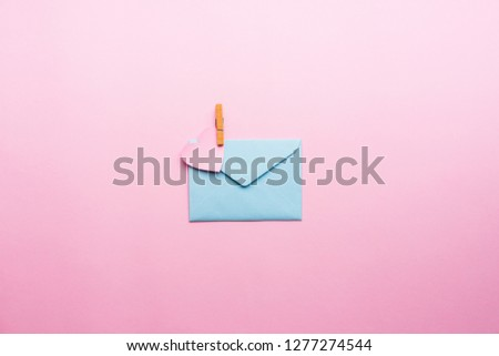 Blue letter with pink heart cartoon style from paper on cardboard background. Valentine day minimal concept Flat lay Top view #1277274544