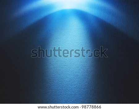 Blue light beam hitting at the rough surface with copy space