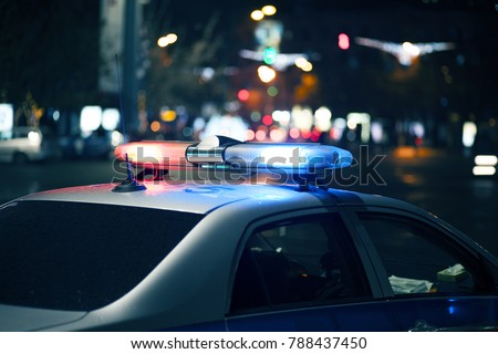 Blue light flasher atop of a police car