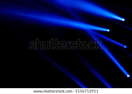 Blue light rays laser sportlight for concert entertainment and clubing effect lighting effect background. #1556712911