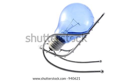 Blue lightbulb in chair; idea concept
