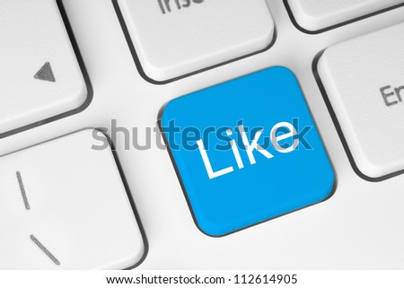 Blue like button on keyboard close-up