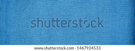 Blue Linen cloth background. Pure linen texture, web wide. Blue canvas background, banner, macro