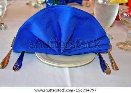 blue linen napkin on dinner table #156934997