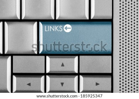 Blue LINKS key on a computer keyboard with clipping path around the LINKS key