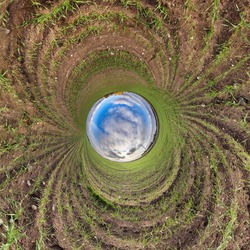 Blue little planet. Inversion of tiny planet transformation of spherical panorama 360 degrees. Spherical abstract aerial view. Curvature of space.