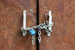 blue lock on the chain rusty door locks transformer station