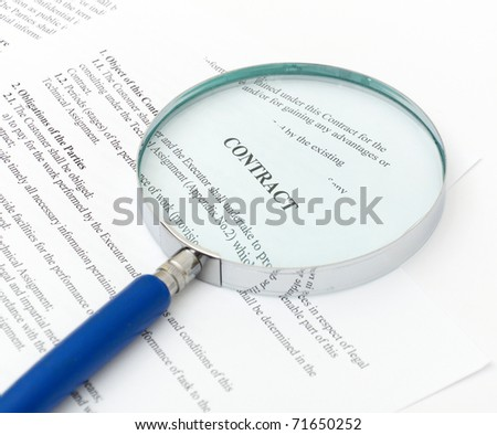 blue Magnifying Glass and document close up - stock photo