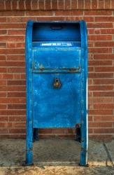 Blue Mailbox - Front - brick wall behind