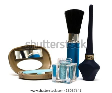 blue make-up eyeshadows and cosmetic brush