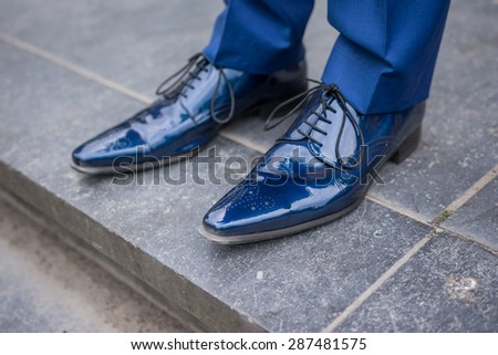 stock-photo-blue-male-leather-lacquered-shoes-from-groom-287481575.jpg