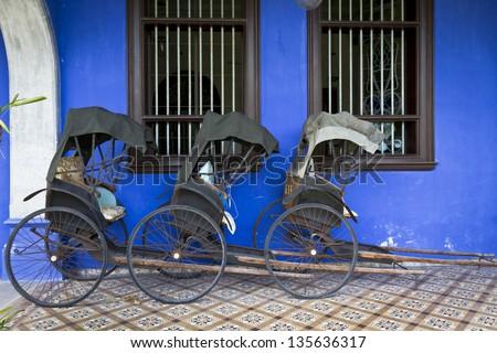 Blue Mansion in Georgetown, Malaysia. Photo of three Tuk-Tuk's.
