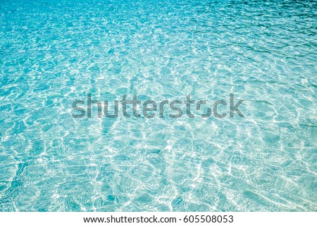 Blue marine pool or sea wave ripple curl water surface texture. Summer holiday relax background with copy space.