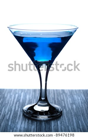 Blue martini cocktail isolated over white background - stock photo