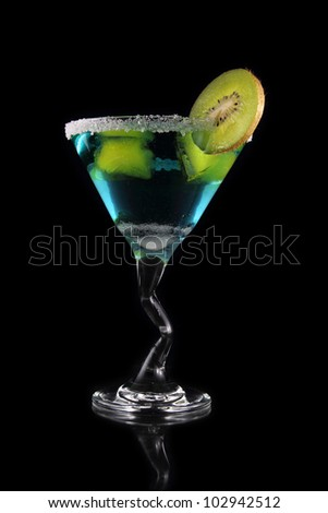 blue martini drink with kiwi and yellow ice on black background