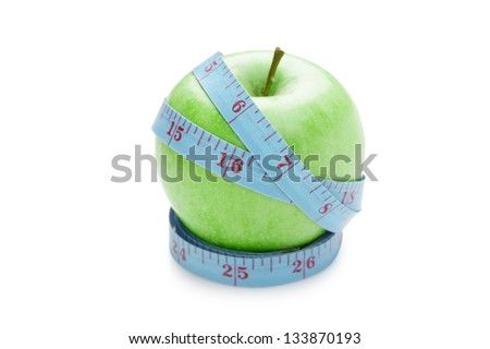 blue measure tape and green apple isolated on white background