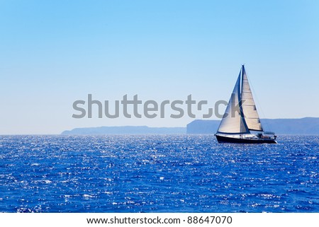 Blue Mediterranean sailboat sailing in perfect ocean at San Antonio cape - stock photo