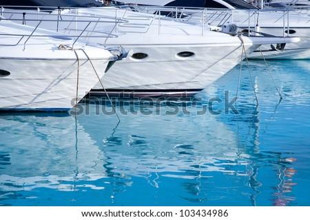 blue mediterranean sea water in marina port of Spain #103434986