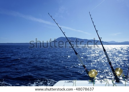 Blue Mediterranean trolling boat fishing saltwater with rods and reels