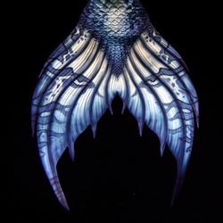 Blue Mermaid tail fluke, design detail, on black background