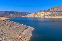 Blue Mesa Reservoir - An Autumn view of Blue Mesa Reservoir at Dillon Gulch, with some tens-millions-years-old rock formations standing on north shore, Curecanti National Recreation Area, CO, USA.