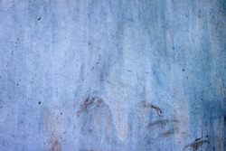 Blue metal sheet with a scratched surface. Texture for the design. Background.