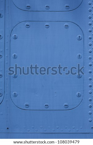 blue metal surface with a hatch on the bolt - stock photo