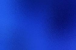 Blue metallic foil paper texture decor background. Metalized paper.