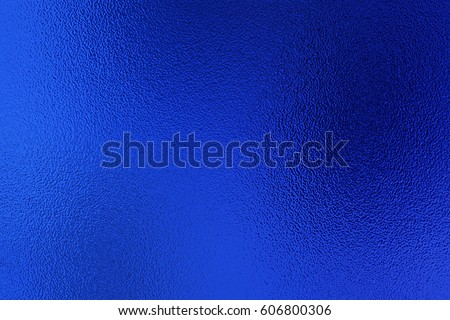 Blue metallic foil paper texture decor background. Metalized paper.