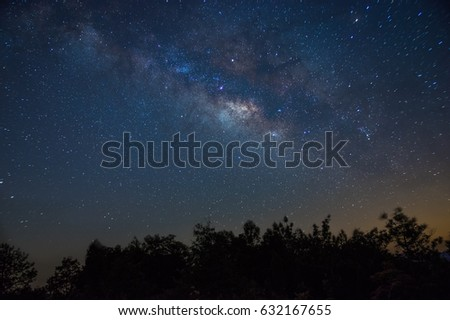 Blue Milky Way over the forest - Shutterstock ID 632167655
