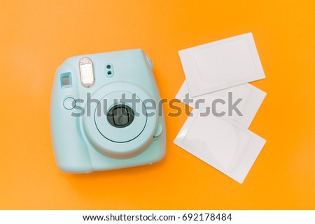 Blue mint instant camera with film