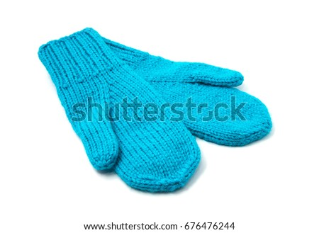 Blue mittens isolated on white background #676476244