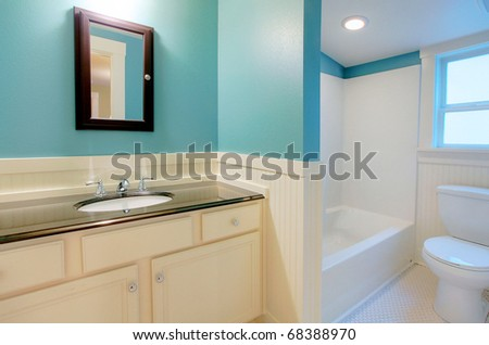 Blue modern bathroom with white tiles.