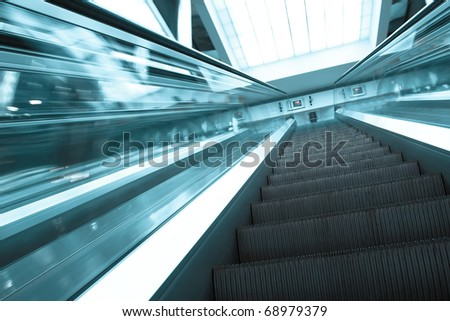blue modern escalator in business center