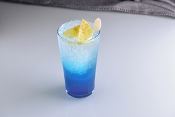 Blue Mojito Mocktail Isolated Garnished with Lemon on a Long Glass