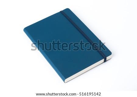 Blue moleskine isolated over white.