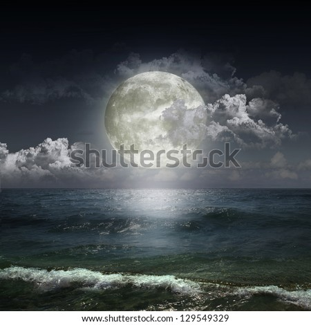 blue moon reflected in water wavy surface - stock photo