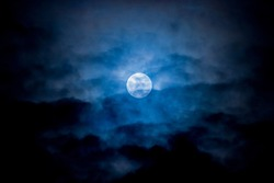 Blue moon surrounding by clouds