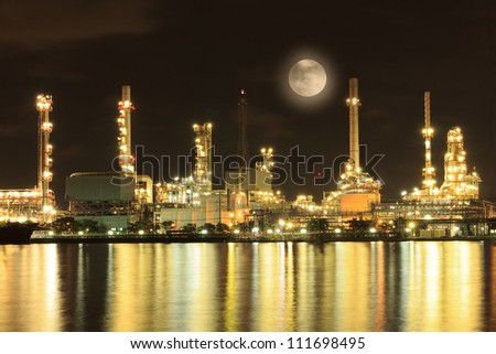 Blue Moon with oil refinery factory and golden reflection on the river.